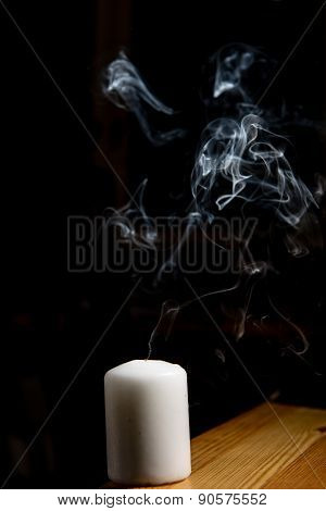 Smoke Coming From A Blown Out Candle