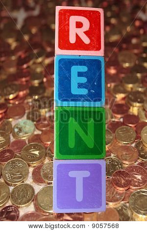 Rent And Coins In Toy Blocks