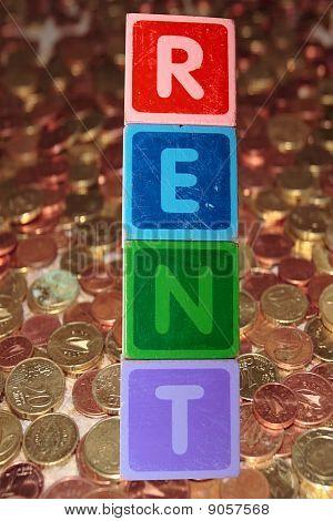Miete und Münzen In Spielzeug-Blöcken
