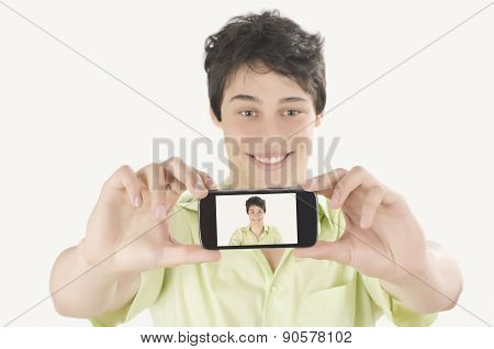 Happy Young Man Taking A Selfie Photo With His Smart Phone. Man Smiling Looking At His Mobile Phone.