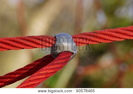 Red ropes and metal part