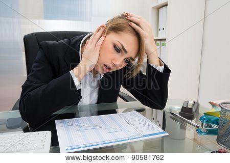 Businesswoman With Gantt Progress Chart At Desk