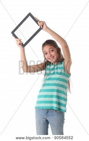 Beautiful pre-teen girl with a tablet computer. Isolated.
