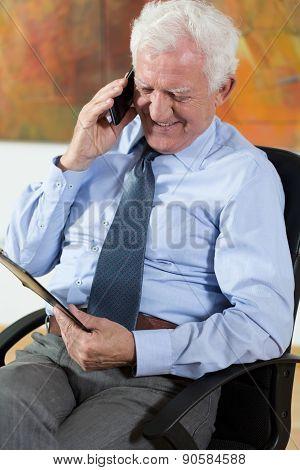 Elder Man Talking On Phone