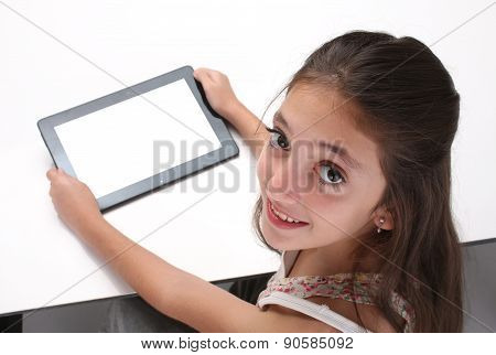 Beaitiful pre-teen girl using a tablet computer.