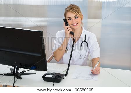 Female Doctor Talking On Telephone