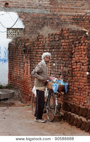Indian Old Man With Bicycle In Village