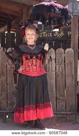A Goldfield Ghost Town Lady In Red, Arizona