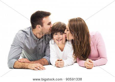 Parents kissing their son