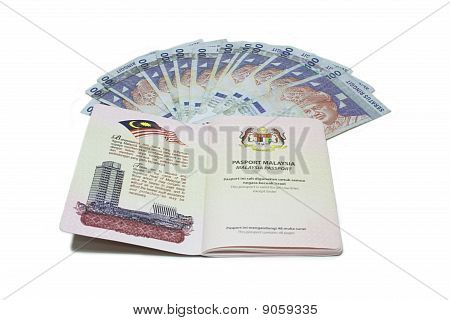 Malaysia passport and RM100 Notes.