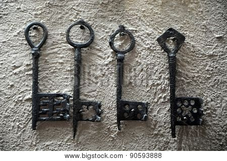Aged Keys On The Cement Wall. Closeup View