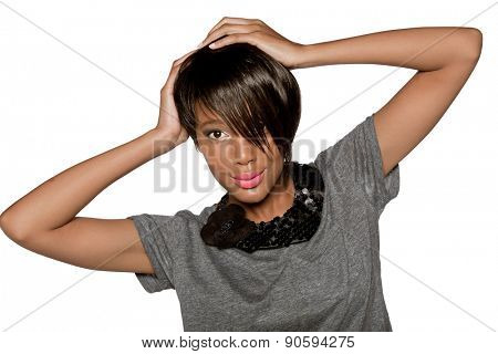beautiful young African woman with short pixie crop hairstyle on studio background