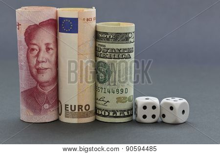 Dice Placed With Three Currencies