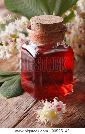 Chestnut Tincture Of Flowers In A Bottle Vertical Closeup