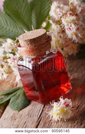 Chestnut Infusion Of Flowers In A Bottle Vertical Closeup