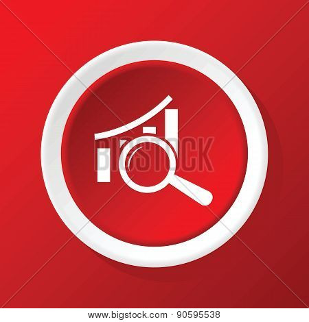 Examine graphic icon on red