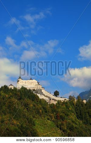 The castle is situated on top of the mountain and surrounded by dense forest.  Majestic medieval fortress-palace Hohenwerfen in Austria