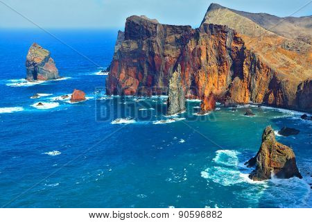 Atlantic storms. Arid eastern tip of the island of Madeira. Colorful pinnacles lit sunset