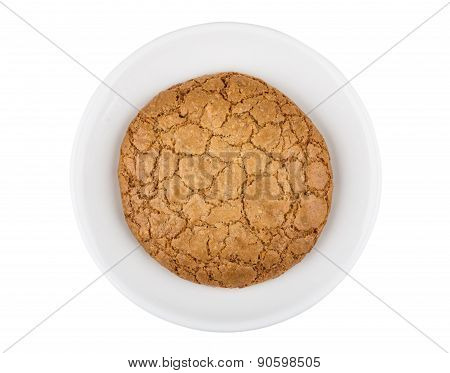 One Cookie In Saucer Isolated On White Background