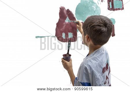 Young Boy Works On Painting.