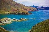stock photo of shoreline  - view of rocky shoreline from cliffs above - JPG