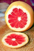 stock photo of market segmentation  - grapefruit bright red and cut by segments - JPG