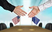 stock photo of european  - Two diplomats from United States and European Union extending their hands for a handshake on an agreement between the countries - JPG