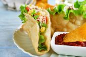 pic of tacos  - Tasty taco with tomato dip on plate on table close up - JPG