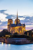 stock photo of notre dame  - Notre Dame Cathedral with Paris cityscape and River Seine at dusk - JPG