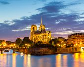 foto of notre dame  - Notre Dame Cathedral with Paris cityscape and River Seine at dusk - JPG