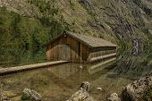 stock photo of dock a pond  - Boat dock hangar at Obersee Berchtesgaden Germany Bavaria - JPG