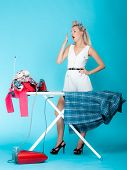 foto of household  - Full length sexy girl retro style ironing male shirt tired woman housewife in domestic role - JPG