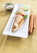 picture of mullet  - fried mullet fish and herb on white plate - JPG