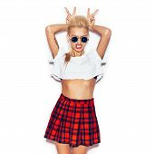 stock photo of up-skirt  - Girl in a white shirt and plaid skirt and sunglasses having fun - JPG