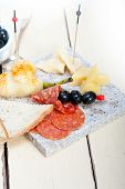 pic of salami  - cold cut assortment cheese salami and fresh pears served on a granite stone - JPG