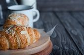 stock photo of croissant  - Fresh baked croissants croissants with soft almond filling - JPG