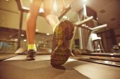 picture of treadmill  - Legs of young woman running on treadmill in gym - JPG