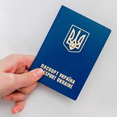 picture of passport cover  - an image of Ukrainian passport in hand on a white background - JPG