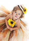 pic of scarecrow  - Adorable toddler dressed as a scarecrow and looking up at the camera - JPG