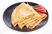 picture of crepes  - crepe with sugar and strawberry - JPG