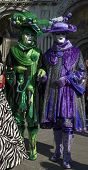 pic of mardi gras mask  - two masked party goers pose in st - JPG