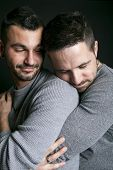 foto of gay wedding  - A gay couple on black background studio - JPG