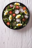 stock photo of radish  - Fresh spring salad with eggs tomato radish and herbs on a plate - JPG