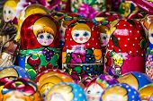 picture of doll  - Colorful Russian nesting dolls matreshka at the market - JPG
