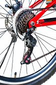 pic of bicycle gear  - rear bicycle wheel with disc brakes and gears on white - JPG