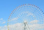 stock photo of ferris-wheel  - Close Up Of Ferris Wheel Over Blue Sky - JPG
