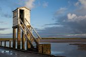 stock photo of early morning  - Sately hut on the Holy Island causeway - JPG