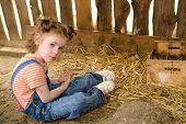 stock photo of hen house  - Child sits on dirty floor in hen coop - JPG