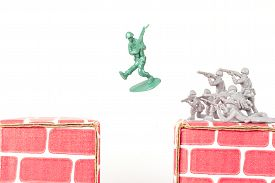 foto of ravines  - Green army man jumps ravine to escape gray army - JPG