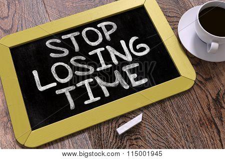 Stop Losing Time Handwritten on Chalkboard.